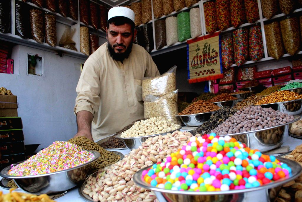 PESHAWAR, Oct. 23, 2016 - A Pakistani vendor waits for customers at a dried fruit market in northwest Pakistan's Peshawar, Oct. 23, 2016. Dried fruits are popular among Pakistani people in winter.