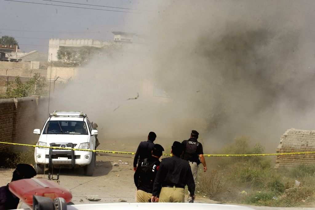 PESHAWAR, Oct. 25, 2016 - Dust and smoke rises after a bomb is detonated by a bomb disposal squad in northwest Pakistan's Peshawar, Oct. 25, 2016. A police constable deployed for the protection of ...
