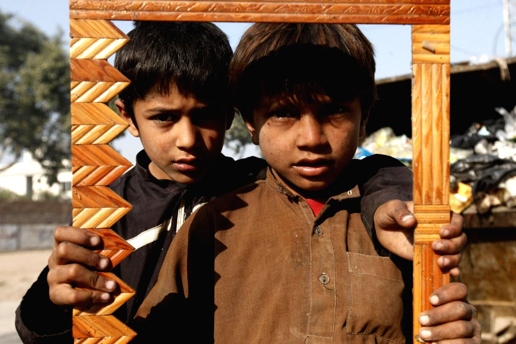 Peshawar (Pakistan): Pakistani boys pose for a photo on Universal Children's Day in northwest Pakistan's Peshawar on Nov. 20, 2014. Universal Children's Day, which falls on Nov. 20 every year, marks .