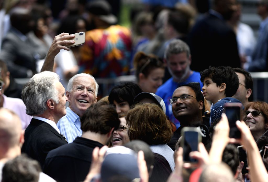 PHILADELPHIA, May 19, 2019 (Xinhua) -- Former U.S. Vice President Joe Biden takes selfie with supporters during a rally in Philadelphia May 18, 2019. Joe Biden on Saturday kicked off his running campaign for the 2020 presidential election in Philadel