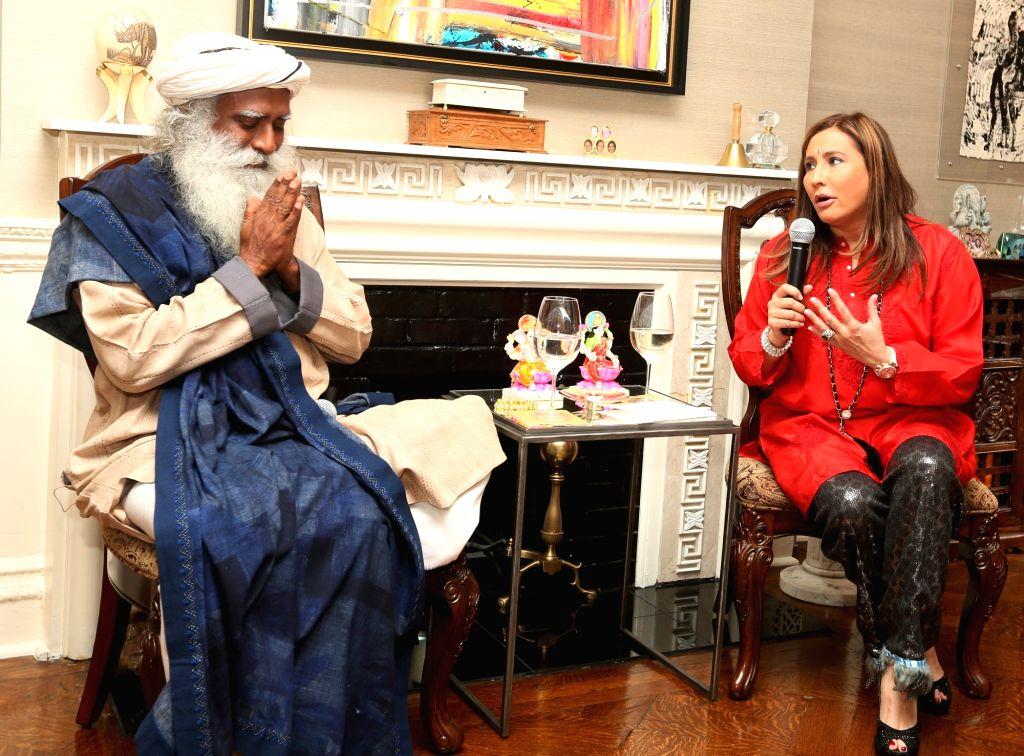 Philanthropist Jaggi Vasudev aka Sadhguru with CEO of Giving Back Foundation Meera Gandhi during a programme in in Jersey City, US on Nov 2, 2015.