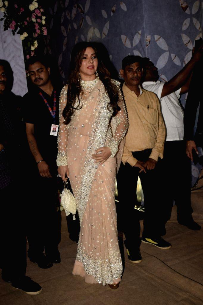 Philanthropist Kaykasshan A Patel arrives to attend NCP leader Praful Patel's daughter Poorna Patel's wedding reception, in Mumbai, on July 22, 2018. - Kaykasshan A Patel, Praful Patel and Poorna Patel