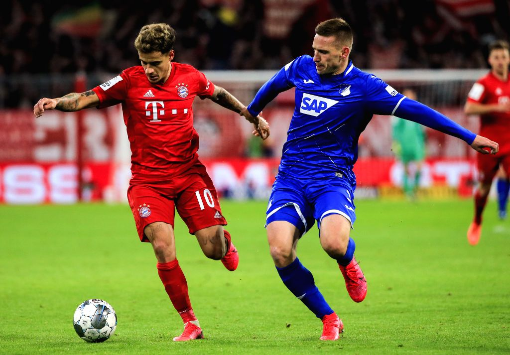 Philippe Coutinho (L) of Bayern Munich vies with Pavel Kaderabek of Hoffenheim during a German Cup 3rd round match between FC Bayern Munich and TSG 1899 Hoffenheim in ...