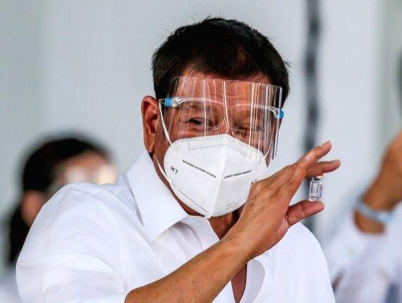 Philippine President Rodrigo Duterte shows a vial of the Sinovac vaccine CoronaVac donated by China in Manila, the Philippines, on Feb. 28, 2021.