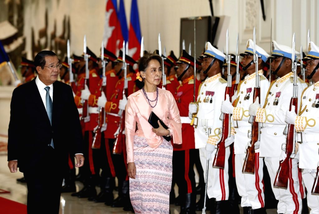 Phnom Penh, April 30, 2019 - Cambodian Prime Minister Samdech Techo Hun Sen (L) and Myanmar's State Councilor Aung San Suu Kyi inspect the guard of honor in Phnom Penh, Cambodia, on April 30, 2019. - Samdech Techo Hun Sen