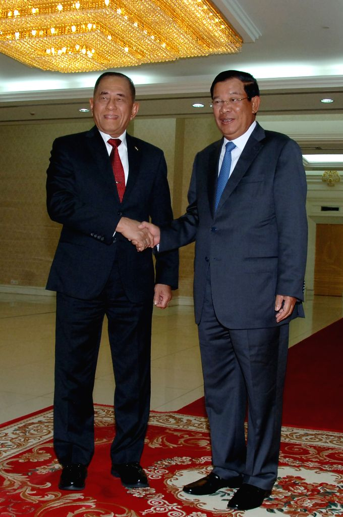 PHNOM PENH, Aug. 10, 2016 - Indonesian Defense Minister Ryamizard Ryacudu (L) shakes hands with Cambodian Prime Minister Samdech Techo Hun Sen in Phnom Penh, Cambodia, Aug. 10, 2016. Ryamizard on ... - Ryamizard Ryacudu