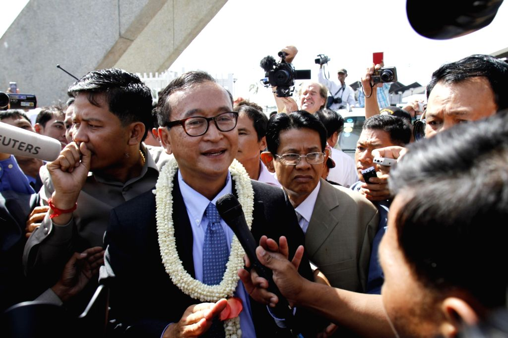 Cambodia's opposition leader Sam Rainsy (C) arrives at Phnom Penh in Cambodia, Aug. 16, 2013. Sam Rainsy on Friday reiterated his call for the ... - Hun Sen