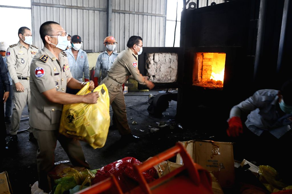 Phnom Penh (Cambodia): Cambodian police burn down fake medicines in Phnom Penh, Cambodia, Nov. 28, 2014. About 5.1 tonnes of counterfeit medicines were burned down on Friday at a dumpsite on the ...