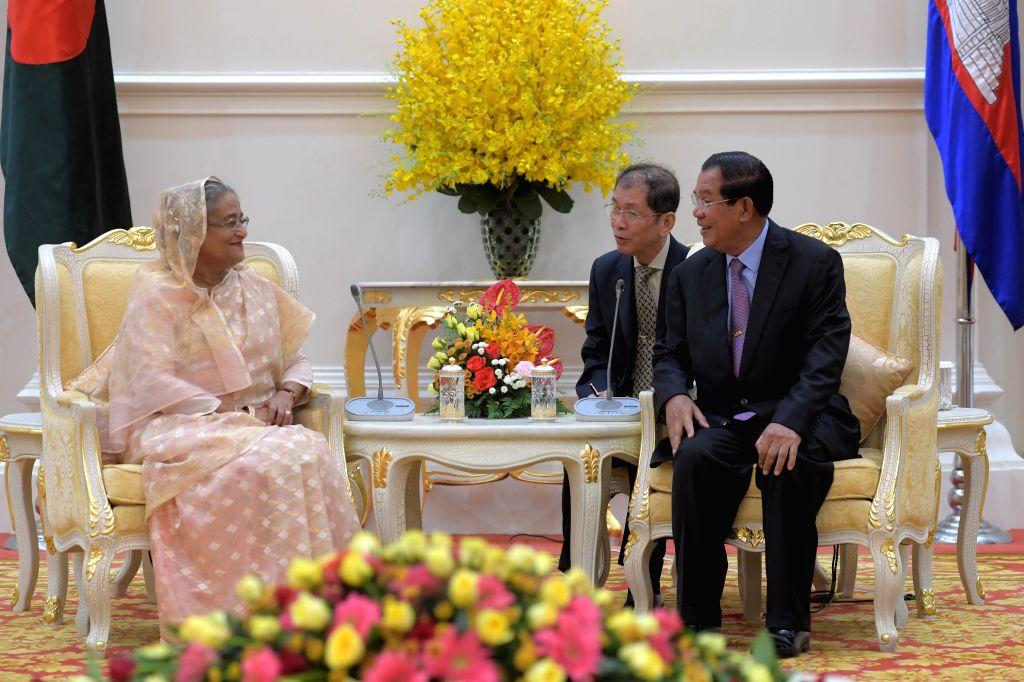 PHNOM PENH, Dec. 4, 2017 - Cambodian Prime Minister Samdech Techo Hun Sen (R) meets with visiting Bangladeshi Prime Minister Sheikh Hasina (L) in Phnom Penh, Cambodia on Dec. 4, 2017. ... - Samdech Techo Hun Sen and Hasina