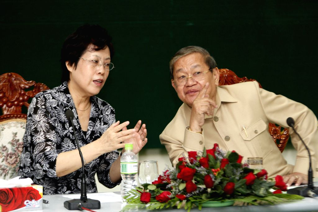 Cambodian Information Minister Khieu Kanharith (R) and Chinese Ambassador to Cambodia Bu Jianguo (L) attend a preparatory meeting for a Cambodia-China art ... - Khieu Kanharith