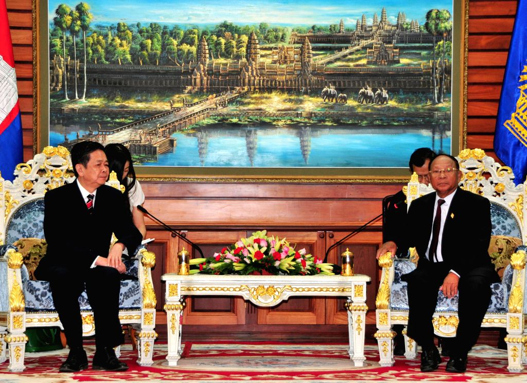 Heng Samrin (R), president of the National Assembly of Cambodia, meets with Qin Ruixiang (L), vice chairman of the Standing Committee of the China's Guangxi ...