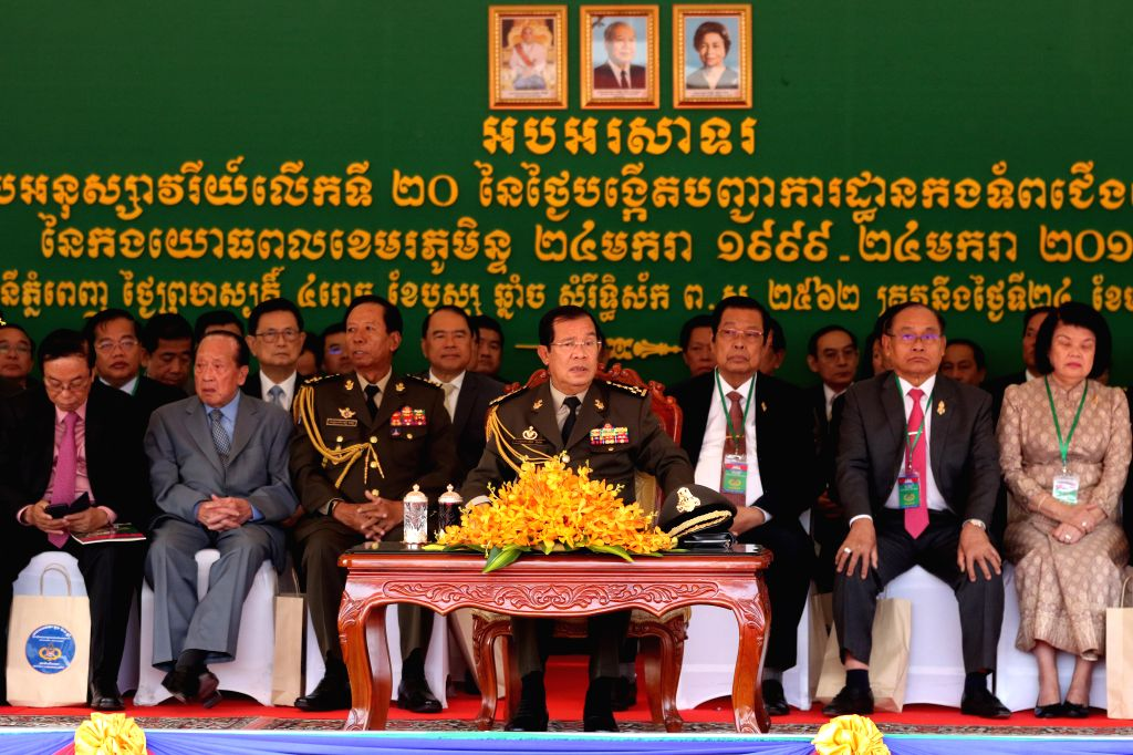 PHNOM PENH, Jan. 25, 2019 - Cambodian Prime Minister Samdech Techo Hun Sen (C) attends  a ceremony in Phnom Penh Jan. 24, 2019. Cambodia on Thursday celebrated the 20th anniversary of the founding of ... - Samdech Techo Hun Sen