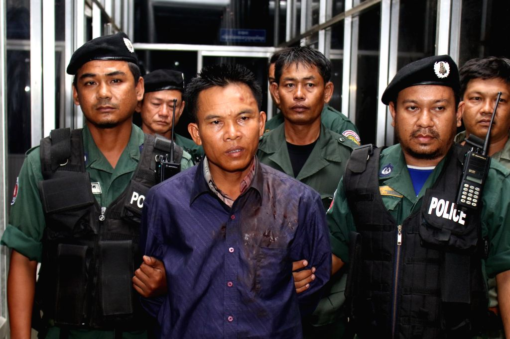 PHNOM PENH, July 10, 2016 - Chuob Samlab (2nd R, front) is arrested on suspicion of killing political analyst Kem Ley in Phnom Penh, Cambodia, July 10, 2016. Cambodian Prime Minister Samdech Techo ... - Samdech Techo Hun Sen