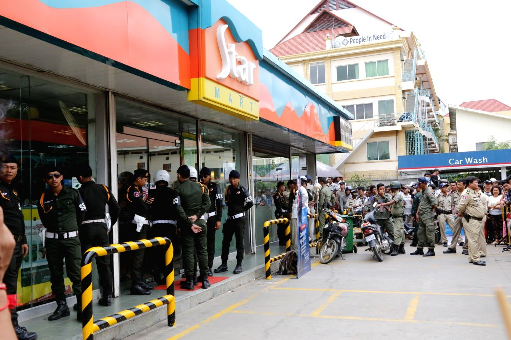 PHNOM PENH, July 10, 2016 - Security forces stand guard outside the mini-mart, where political analyst Kem Ley was shot dead in Phnom Penh, Cambodia, July 10, 2016. Cambodian Prime Minister Samdech ... - Samdech Techo Hun Sen