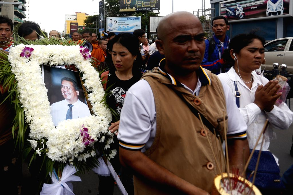 PHNOM PENH, July 10, 2016 - Sympathizers escort the body of prominent political analyst Kem Ley to a pagoda in Phnom Penh, Cambodia, July 10, 2016. Cambodian Prime Minister Samdech Techo Hun Sen on ... - Samdech Techo Hun Sen