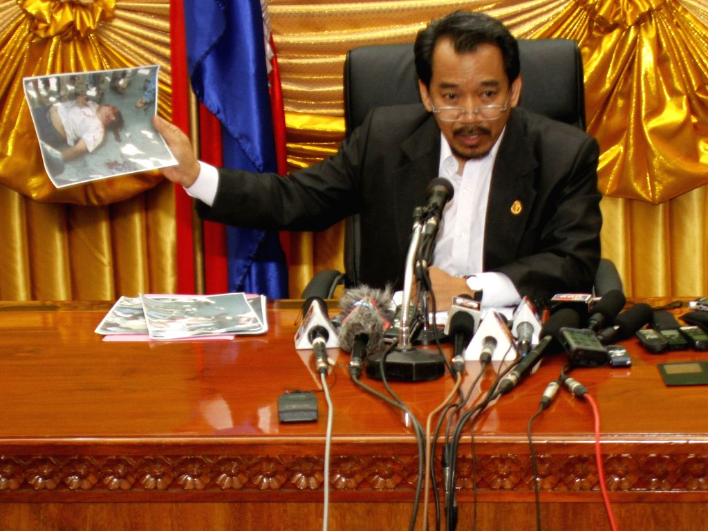 Keo Remy, Secretary of State of the Council of Ministers, speaks during a press conference in Phnom Penh, Cambodia, July 16, 2014. Five Cambodian opposition ...
