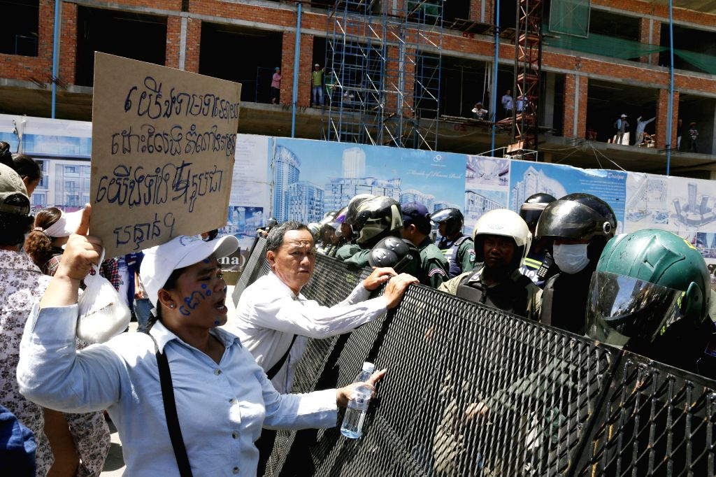 Opposition supporters gather outside the Phnom Penh Municipal Court to call for the release of five Cambodian opposition Members of Parliament (MPs)-elect in ...