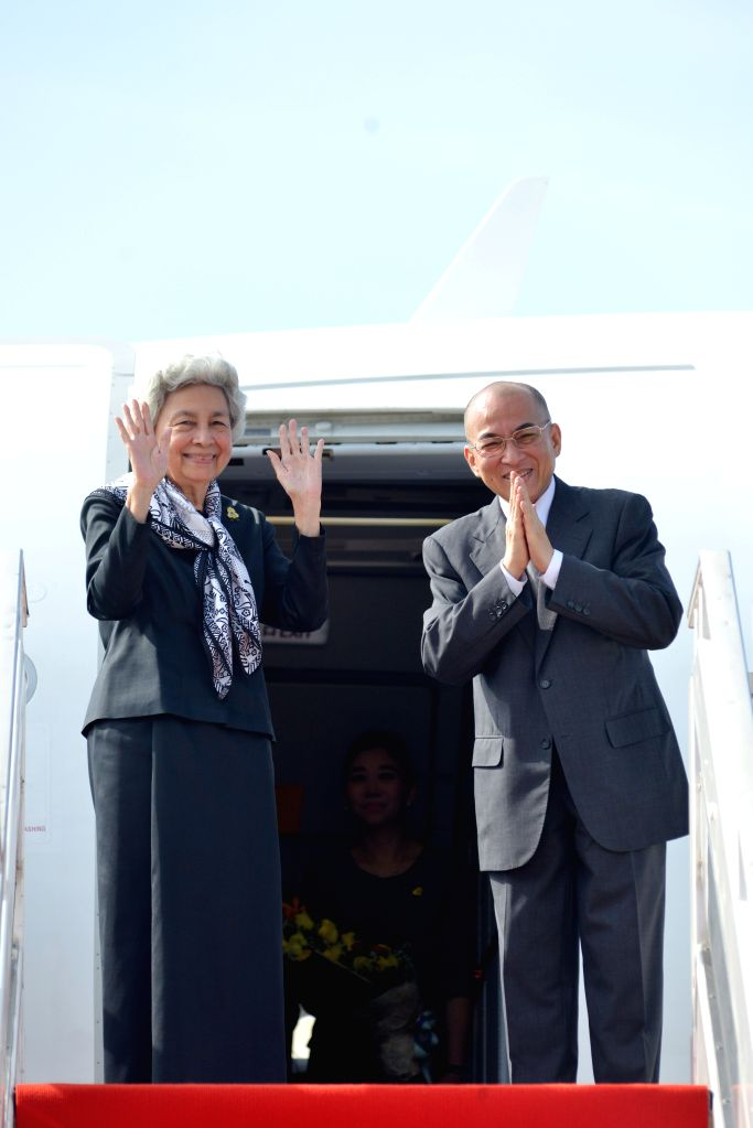 PHNOM PENH, July 5, 2016 - Cambodian King Norodom Sihamoni (R) and his mother, former Queen Norodom Monineath, gesture from a plane in Phnom Penh, Cambodia, July 5, 2016. Sihamoni and former Queen ...