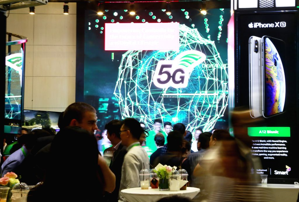 PHNOM PENH, July 8, 2019 (Xinhua) -- People visit the first 5G live trial showcase held by Smart Axiata in Phnom Penh, Cambodia, on July 8, 2019. Cambodia's leading mobile telecommunications company Smart Axiata has partnered with China's technology