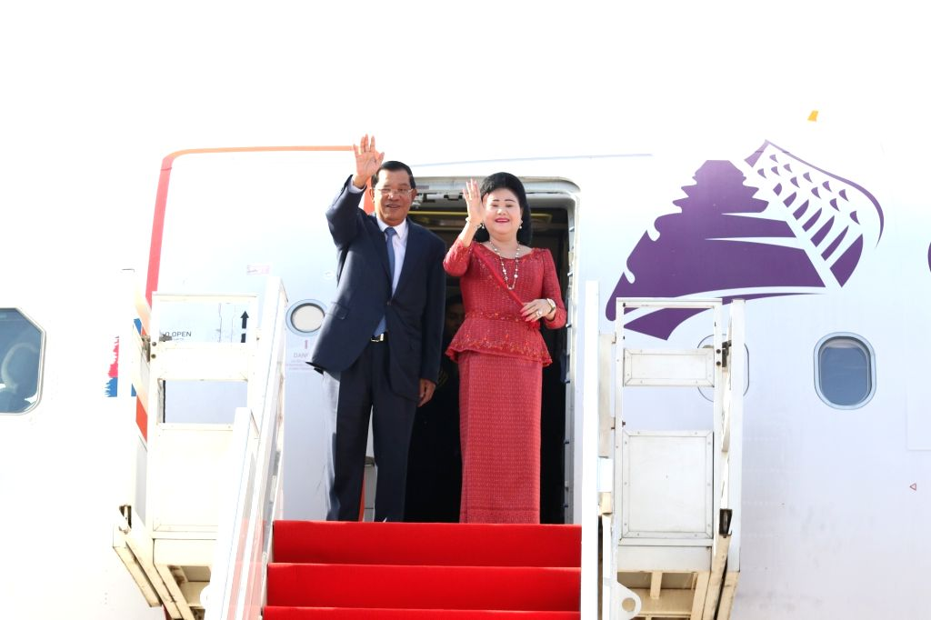 PHNOM PENH, June 1, 2016 - Cambodian Prime Minister Samdech Techo Hun Sen (L) and his wife Bun Rany gesture from a plane in Phnom Penh, Cambodia, June 1, 2016. Cambodian Prime Minister Samdech Techo ... - Samdech Techo Hun Sen