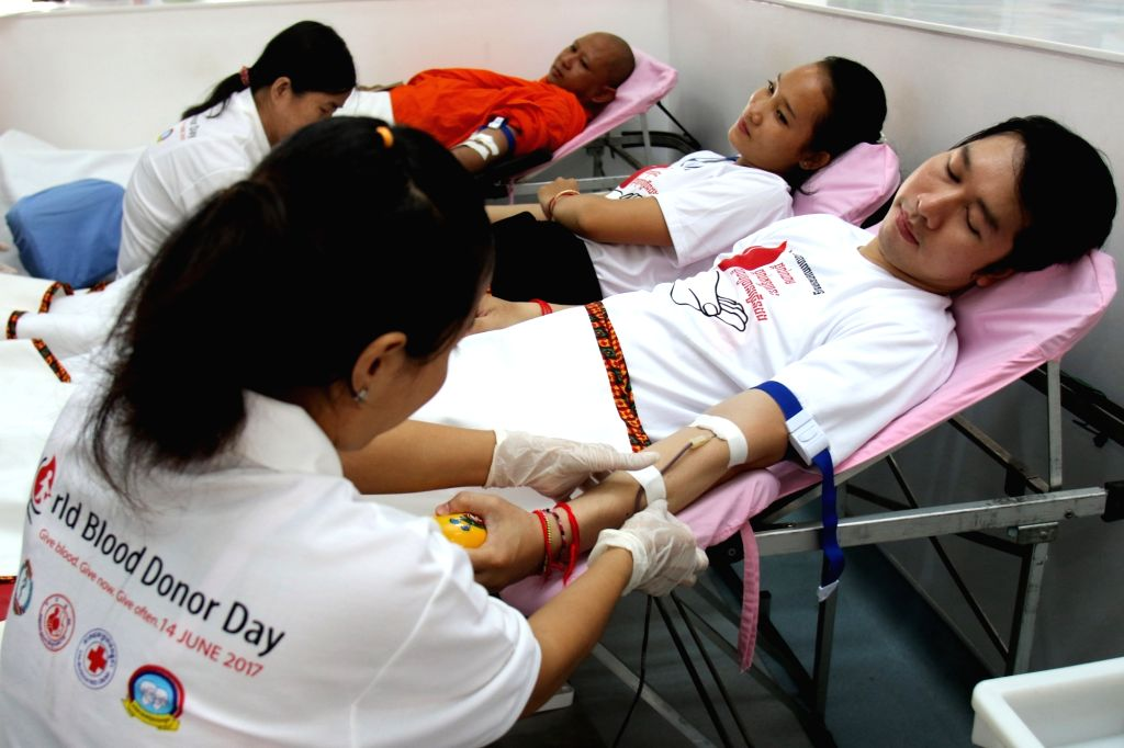 PHNOM PENH, June 14, 2017 - People donate blood on the World Blood Donor Day in Phnom Penh, Cambodia, on June 14, 2017. Liu Yunguo, World Health Organization (WHO) Representative to Cambodia, on ...