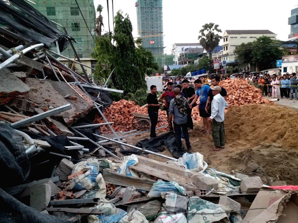 PHNOM PENH, June 22, 2019 (Xinhua) -- Photo taken on June 22, 2019 shows the scene where a building collapsed in Preah Sihanouk, Cambodia. The death toll in the collapse of a seven-story building, which was under-construction, in southwestern Cambodi