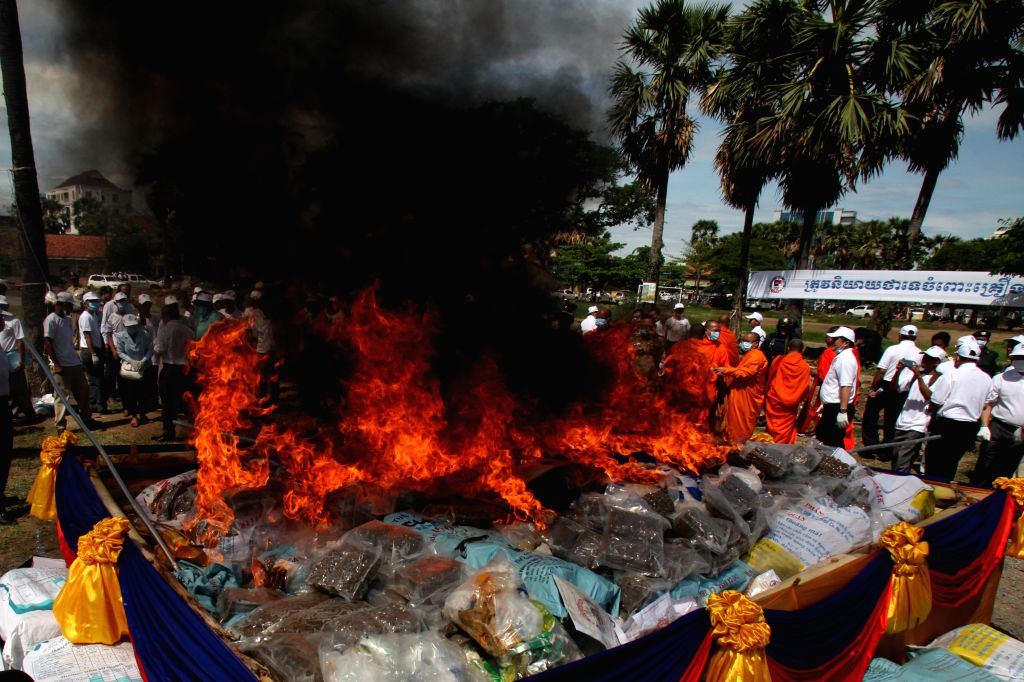 PHNOM PENH, June 26, 2016 - Piles of drugs are burned down in Phnom Penh, Cambodia, June 26, 2016. The Cambodian authorities on Sunday ceremonially burned down about 1.56 tons of marijuana, ...
