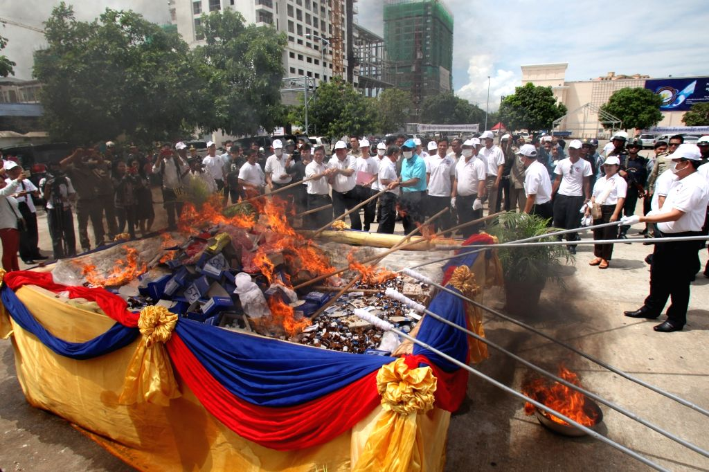 PHNOM PENH, June 26, 2017 - Cambodian anti-drug officials set fire on illicit drugs in Phnom Penh, Cambodia, on June 26, 2017. Cambodia destroyed 126.31 kg of illicit drugs with a value of about 4 ...