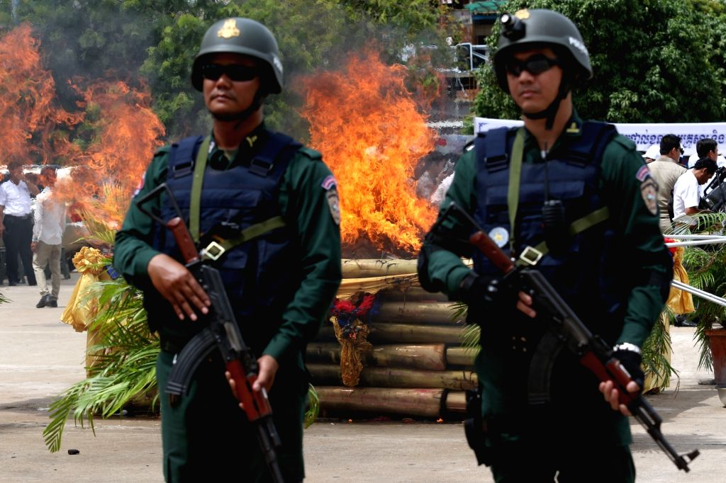 PHNOM PENH, June 26, 2017 - Cambodian police officers stand guard as illicit drugs being destroyed in Phnom Penh, Cambodia, on June 26, 2017. Cambodia destroyed 126.31 kg of illicit drugs with a ...