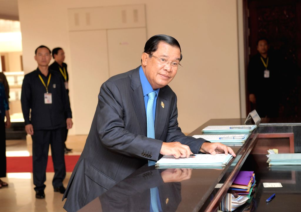 PHNOM PENH, June 30, 2016 - Cambodian Prime Minister Samdech Techo Hun Sen (front) registers his attendance at the National Assembly in Phnom Penh, Cambodia, June 30, 2016. The National Assembly of ... - Samdech Techo Hun Sen