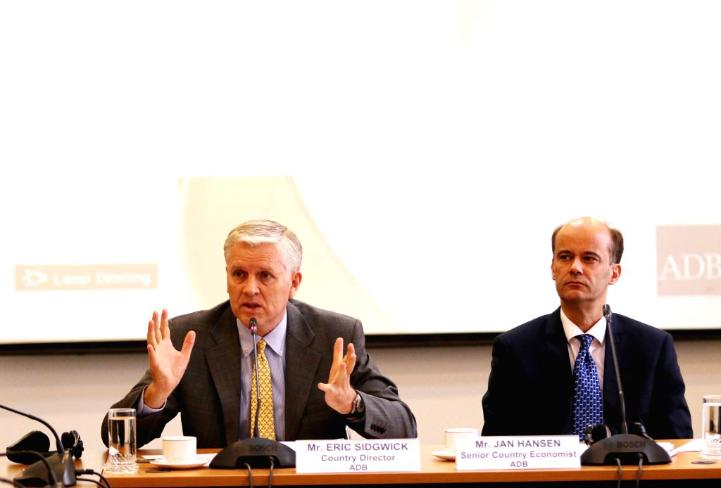 Asian Development Bank (ADB)'s Country Director for Cambodia Eric Sidgwick (L) speaks at a press conference in Phnom Penh, Cambodia, March 24, 2015. Cambodia's ...