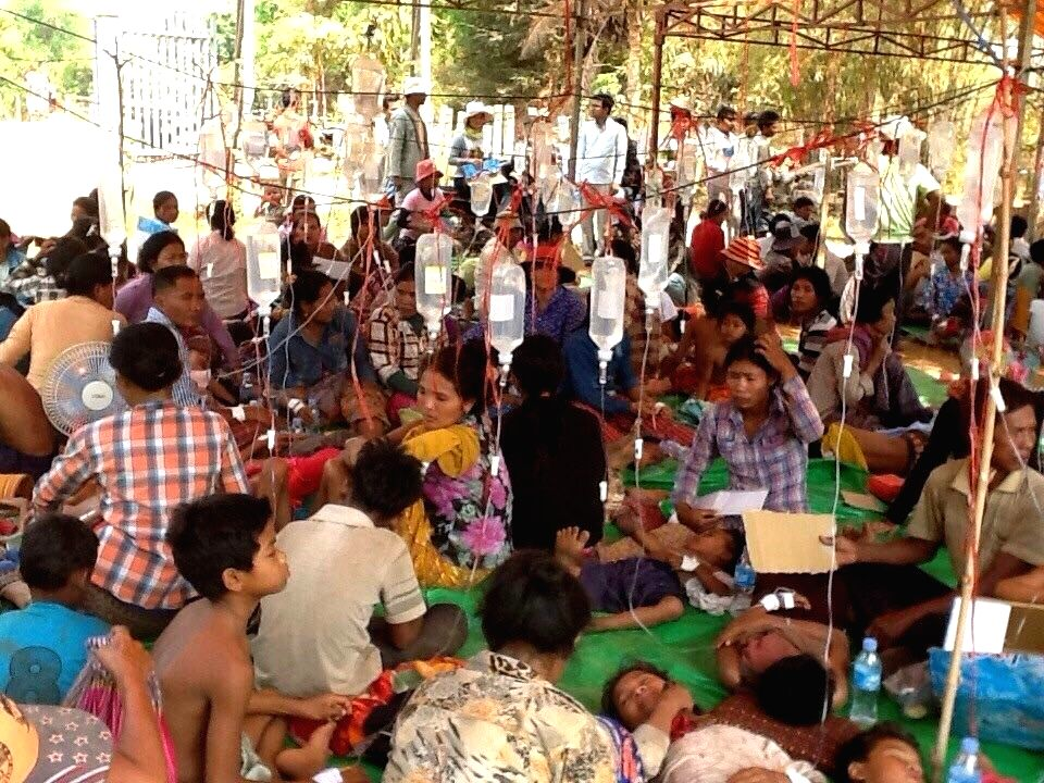 Sick children receive intravenous injections at a health center in Siem Reap province, Cambodia, March 28, 2015. Approximately 570 Cambodian people, mostly ...