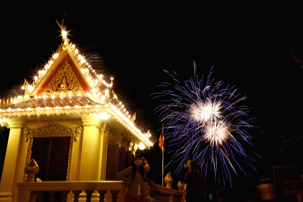 Fireworks light up the sky in Phnom Penh, Cambodia on May 14, 2014. Fireworks were shot into the sky across Tonle Sap River in front of the Royal Palace here ...