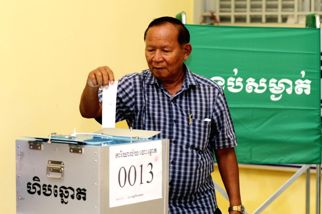 PHNOM PENH, May 26, 2019 - A man puts his ballot paper into a ballot box at a polling station in Phnom Penh, Cambodia on May 26, 2019. The third mandate municipal, provincial, town and district ...