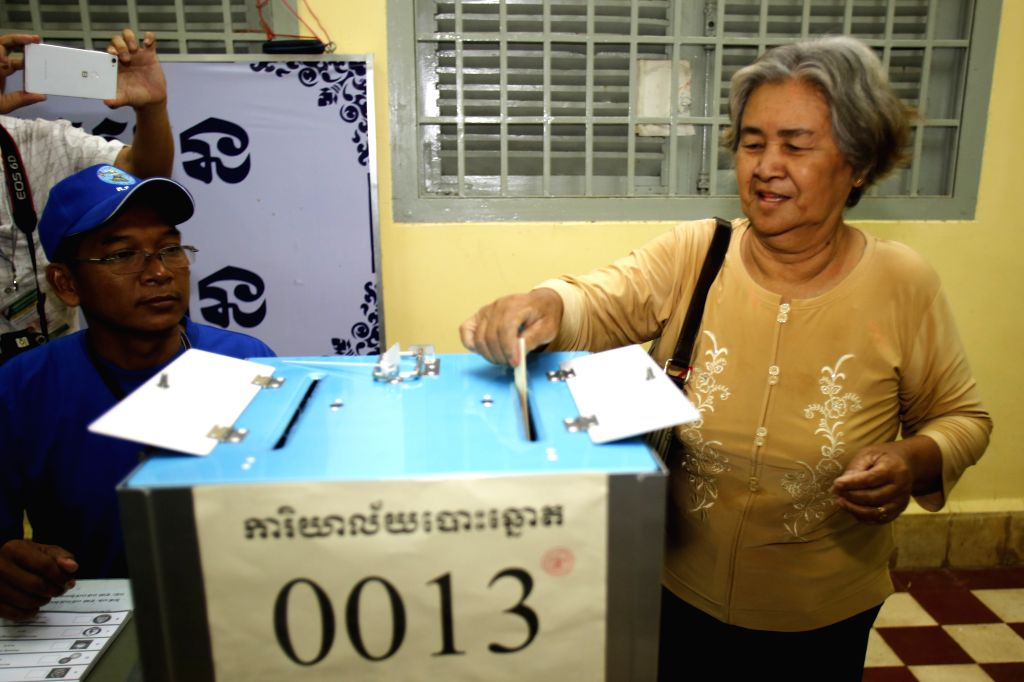 PHNOM PENH, May 26, 2019 - A woman puts her ballot paper into a ballot box at a polling station in Phnom Penh, Cambodia on May 26, 2019. The third mandate municipal, provincial, town and district ...
