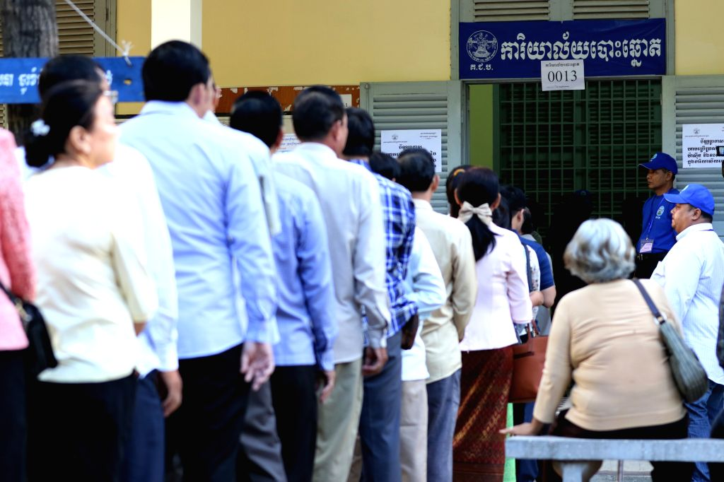 PHNOM PENH, May 26, 2019 - People line up to vote at a polling station in Phnom Penh, Cambodia on May 26, 2019. The third mandate municipal, provincial, town and district council elections kicked off ...