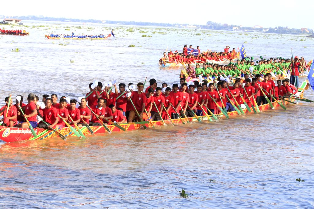 PHNOM PENH, Nov. 13, 2016 - Racers row boats during a regatta to celebrate the Water Festival in Phnom Penh, Cambodia, Nov. 13, 2016. Hundreds of thousands of Cambodians have traveled to Phnom Penh, ...