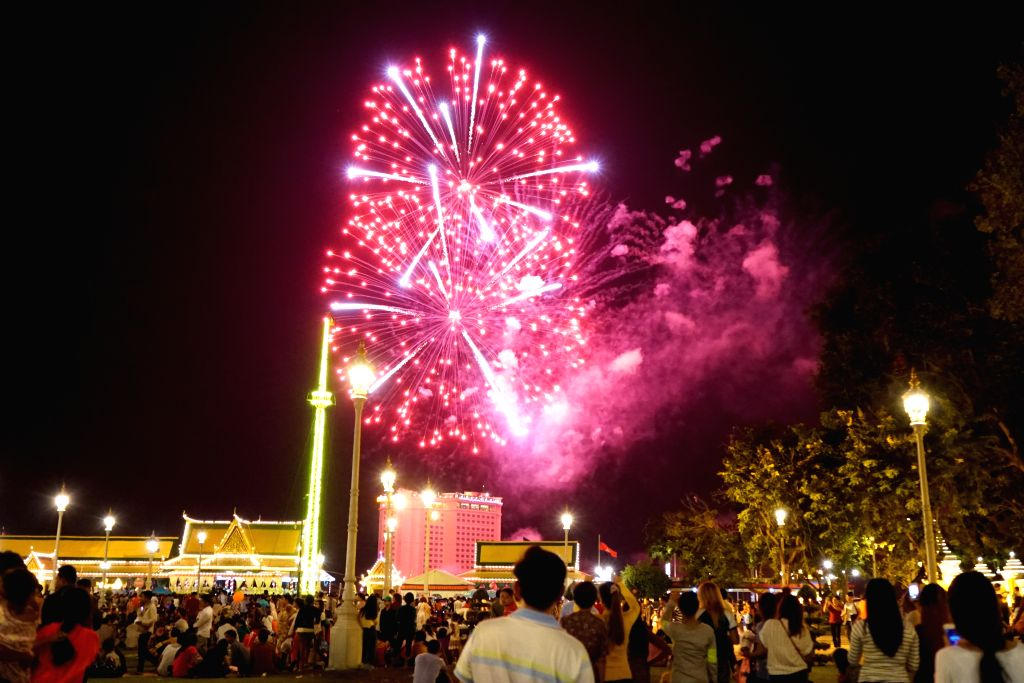 PHNOM PENH, Nov. 14, 2016 - People watch fireworks celebrating the annual Water Festival in Phnom Penh, Cambodia, Nov. 13, 2016. The 3-day Water Festival kicked off here on Sunday.