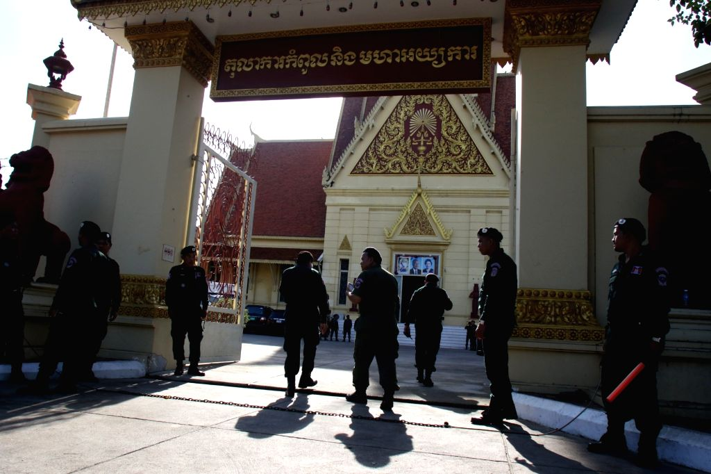PHNOM PENH, Nov. 16, 2017 (Xinhua) -- Security forces stand guard at the entrance of the Supreme Court in Phnom Penh, Cambodia, on Nov. 16, 2017. The Cambodia's Supreme Court on Thursday ordered the dissolution of the country's biggest opposition par