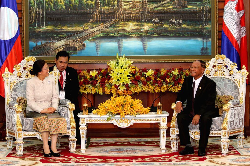 PHNOM PENH, Nov. 25, 2016 - Cambodian National Assembly president Samdech Heng Samrin (R) meets with visiting Laos National Assembly president Pany Yathotou (L) in Phnom Penh, Cambodia, Nov. 25, ...