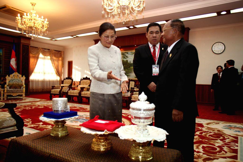 PHNOM PENH, Nov. 25, 2016 - Cambodian National Assembly president Samdech Heng Samrin (R, front) meets with visiting Laos National Assembly president Pany Yathotou (L) in Phnom Penh, Cambodia, Nov. ...