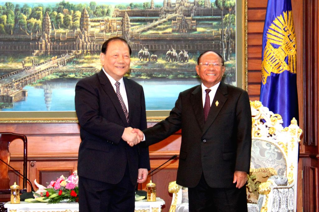 PHNOM PENH, Oct. 17, 2016 - Cambodia's National Assembly President Samdech Heng Samrin (R) shakes hands with Bai Zhijian, chairman of Overseas Affairs Committee of the 12th National People's Congress ...