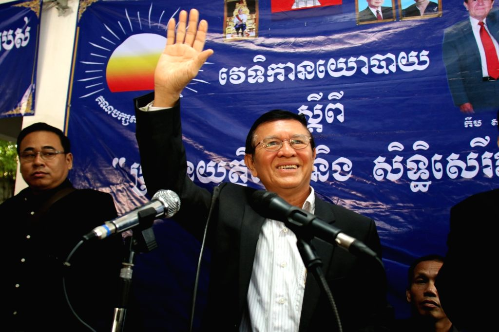 PHNOM PENH, Oct. 5, 2016 - Kem Sokha, deputy leader of the main opposition Cambodia National Rescue Party (CNRP), gestures to his supporters at the CNRP's headquarters in Phnom Penh, Cambodia, Oct. ...