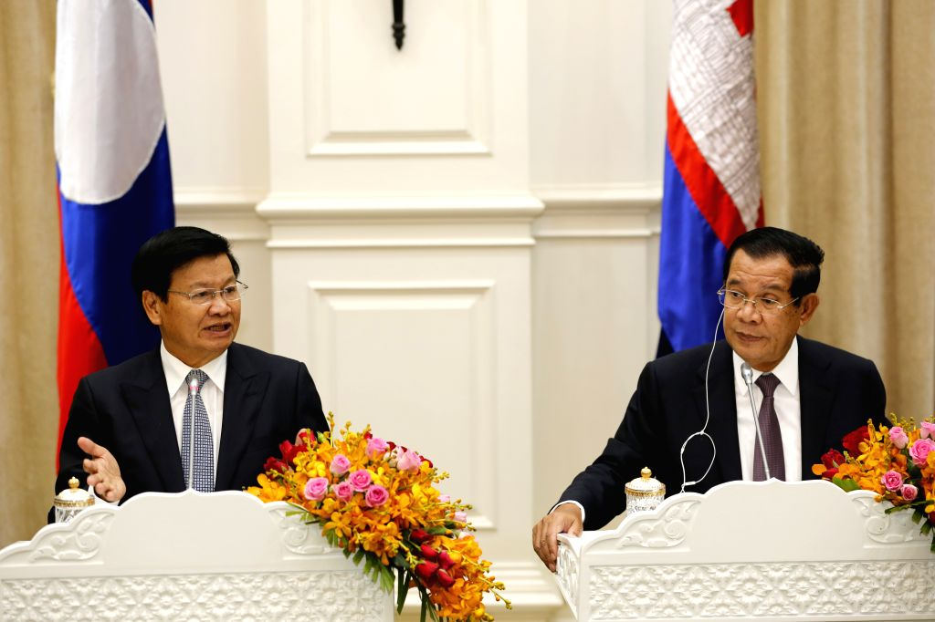 PHNOM PENH, Sept. 13, 2019 - Cambodian Prime Minister Samdech Techo Hun Sen (R) and visiting Lao Prime Minister Thongloun Sisoulith attend a joint press conference in Phnom Penh, Cambodia, Sept. 12, ... - Samdech Techo Hun Sen
