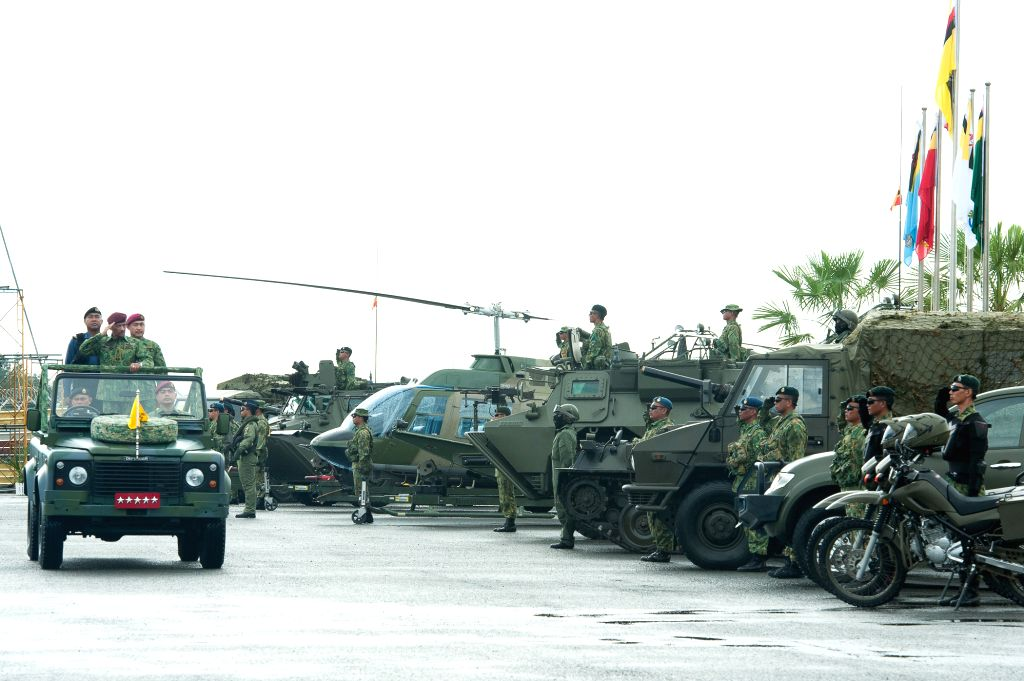 Photo provided by Brunei's Information Department shows Brunei's Sultan Haji Hassanal Bolkiah (C on the vehicle), who is also the country's Minister of ...