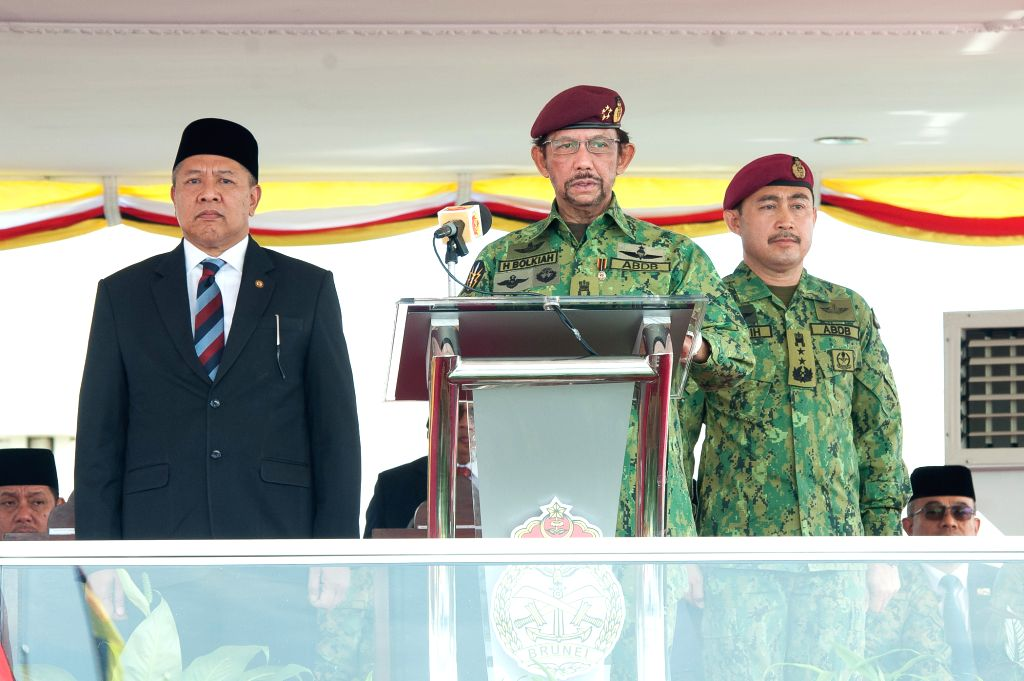 Photo provided by Brunei's Information Department shows Brunei's Sultan Haji Hassanal Bolkiah (C), who is also the country's Minister of Defense and ...