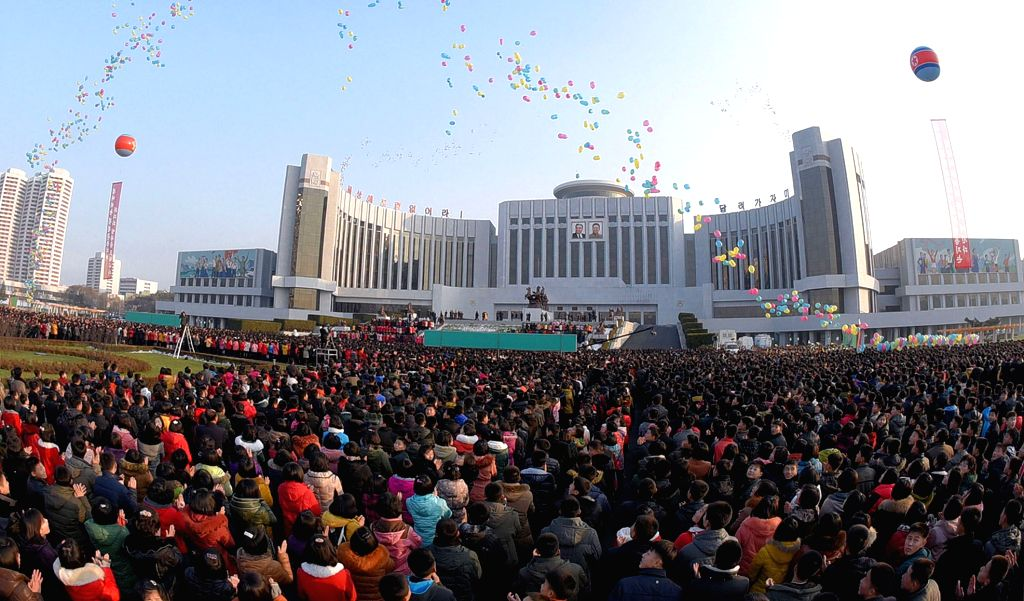 Photo provided by Korean Central News Agency (KCNA) on Dec. 9, 2015 shows a completion ceremony of the reconstruction project of Mangyongdae Schoolchildren's ...