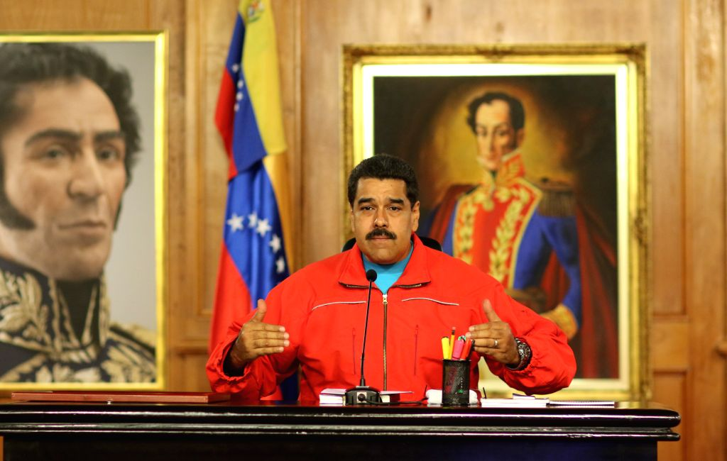 Photo provided by Venezuela's Presidency shows Venezuelan President Nicolas Maduro delivering a speech during a press conference after the results of the ...