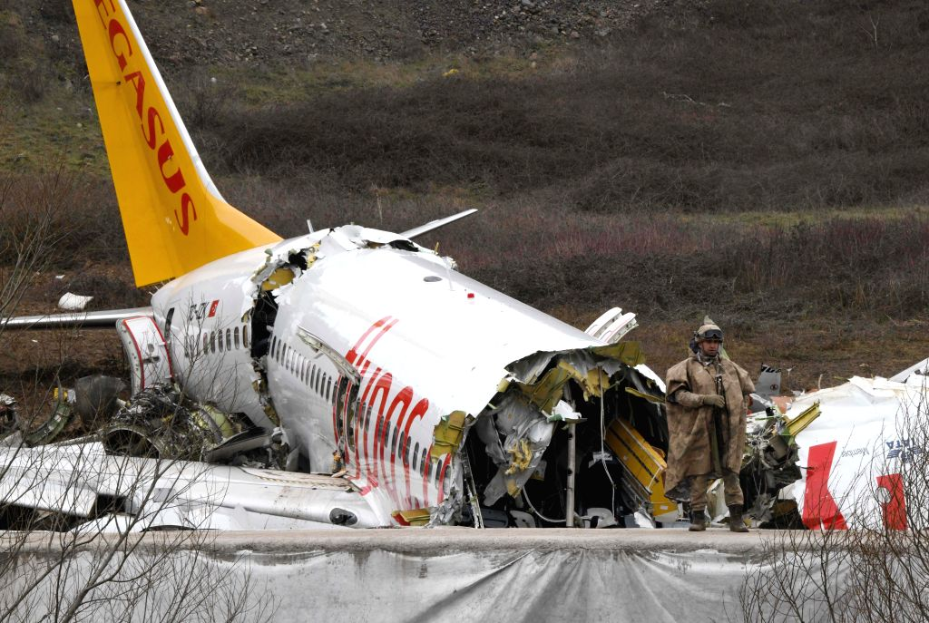 Photo shows the accident site of a plane sliding off the runway at Istanbul's Sabiha Gokcen International Airport in Turkey on Feb. 6, 2020. Two Chinese nationals ...