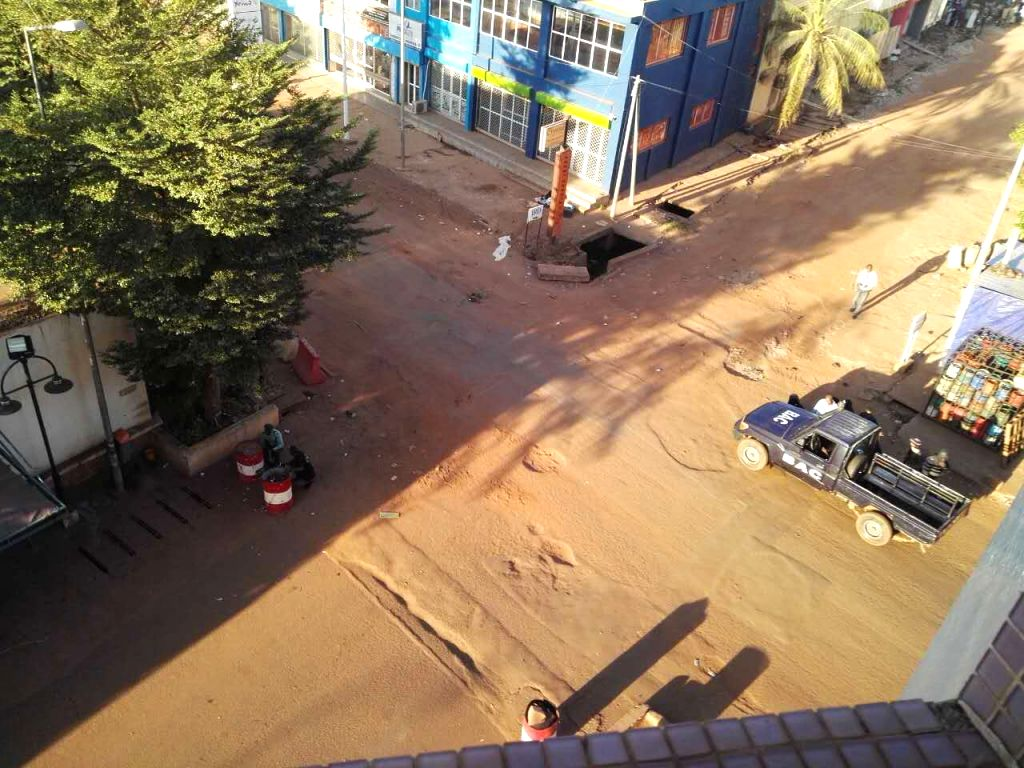 Photo taken by a Chinese tourist using cell phone shows Mali Police taking position during a siege of the gunmen attacked hotel in Bamako, Mali, Nov. 20, 2015. A ...